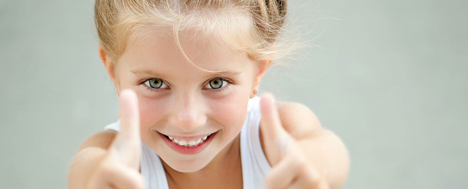 Girl with thumbs up - Pediatric Dentist in Springfield, MO